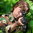 Stock Photo: Soldier aiming the rifle