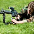Soldier in the field reloading the gun — Stock Photo #10241856