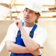Stock Photo: Builder looking at the construction project