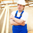 Stock Photo: Builder looking at construction project
