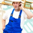 Stock Photo: Builder on mobile phone