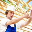 Builder looking at the construction project - Stockfoto