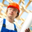Worker looking at the construction project — Stock Photo #10241951