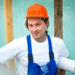Builder with construction plan — Stock Photo #10241993