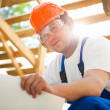 Builder looking at the construction project — Stock Photo
