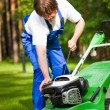 Lawn mower man start up the engine — Stock Photo #10242051