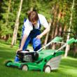 Lawn mower man start up the engine — Stock Photo