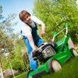 Lawn mower man start up the engine — Stock Photo #10242057