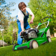 Lawn mower man start up the engine — Stock Photo #10242060