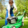Lawn mower man start up the engine — Stock Photo #10242062