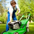 Lawn mower man start up the engine — Stock Photo #10242065