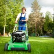 Lawn mower man on the backyard — Stock Photo