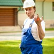 Builder manager holding the keys — Stock Photo #10242079