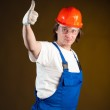 Construction worker holding thumbs up — Stock Photo