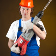 Worker holding a machine drill — Stock Photo