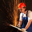 Worker cutting metal - Stock Photo