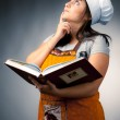 Woman cook holding recipes book and thinking what to cook — Stock Photo