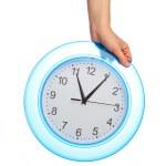 Hand holding office clock — Stock Photo #10243800