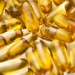 Omega-3 fish fat oil capsules - Stock Photo