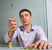 Man throwing up a coin — Stock Photo