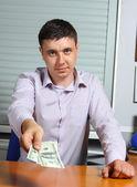 Man offering money — Stock Photo