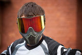 Man wearing a paintball mask — Stok fotoğraf