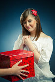 Beautiful girl recieves a gift — Stock Photo