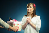 Beautiful young woman recieves a gift — Stock Photo