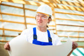 Builder manager looking at the construction project — Stock Photo
