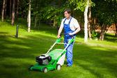 Lawn mower man on the backyard — Stock Photo