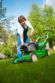 Lawn mower man start up the engine — Stock Photo