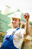 Builder manager delivering the house — Stock Photo