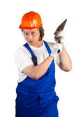 Worker holding a hammer isolated on white — Stock Photo