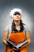 Woman cook reading recipes — Stock Photo