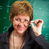Smiling teacher with glasses — Stock Photo
