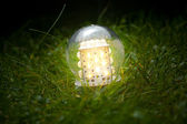 Led lamp on the grass — Stock Photo