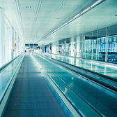 Airport interior with moving stairway, picture taken at Munich Airport — Stock Photo