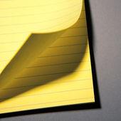 Yellow paper page peel — Stock Photo