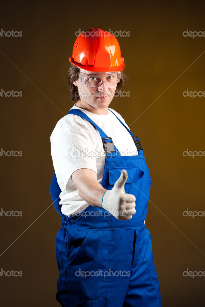 Construction worker holding thumbs up — Stock Photo #10242166