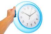 Hand holding blue office clock — Stock Photo
