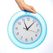 Hand holding office clock — Stock Photo