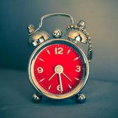 Vintage red alarm clock — Stock Photo