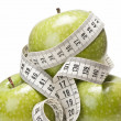 Centimeters and apples. - Stock Photo