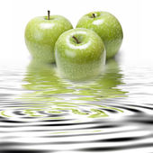 Smith apples reflected. — Stock Photo