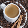 Espresso over coffe beans. — Stock Photo #9210417