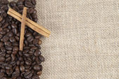 Coffee beans and cinnamon on a burlap. — Stock Photo
