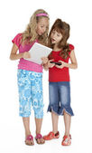 Two Little Girls with Tablet Device — Stock Photo