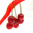 Stock Photo: Cherries on fork