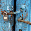Royalty-Free Stock Photo: Rusty wooden door with padlock