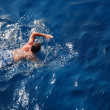 Stock Photo: Swimming man